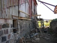Exterior of the front foundation wall of the Sutherland-Wilson Barn, now nearly restored.