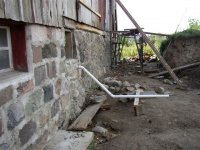 Restored north foundation wall of Sutherland-Wilson barn, showing installed conduit for future uses.