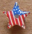 Light-up pin with star design.