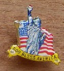 Light-up pin with Statue of Liberty design.