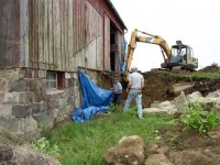 Removing the silo and dirt ramp to facilitate repair of the north foundation wall.