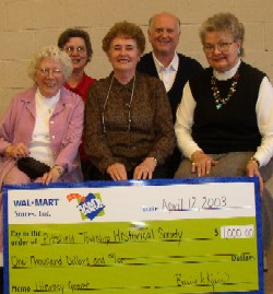 Pittsfield Township Historical Society accepting $1000 check from Sams Club.